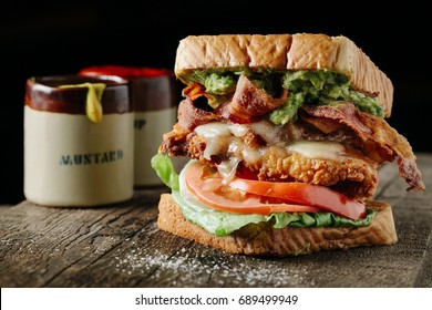 BLT sandwich with fried chicken and avocado