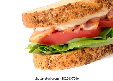 BLT sandwich with wholemeal bread on white background