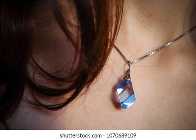 Blu Sky pendant with topaz uncut stone on a silver chain.