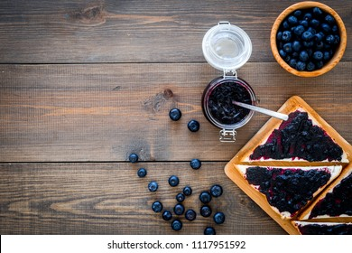 Bluberry toast for breakfast on dark wooden background top view space for text