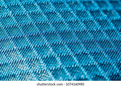 Blue 3d texturised technological seamless breathing fabric closeup.