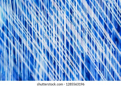 Blue abstrac tbackground with diagonal  crossing light lines