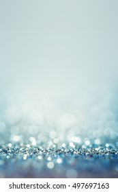 Blue  abstract background with defocused sparkle lights and bokeh