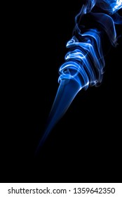 Blue  abstract smoke from incense stick isolated on black background.