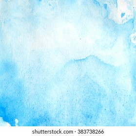 Blue abstract watercolor hand painted background on paper texture.