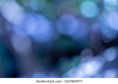 Blue abstrakt background with bokeh effect. Blue cold bokeh pattern texture. Blurred abstract background.