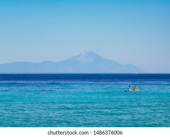 blue aegean sea with mountain view