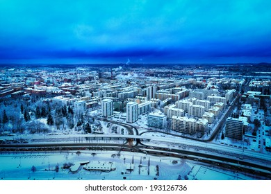 Blue aerial view of city of Tampere in winter