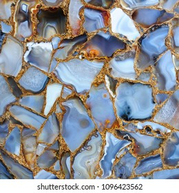 Blue Agate Marble texture with Golden veins. Polished Quartz Stone Background With an elegant play of colors