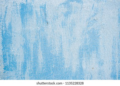 Blue aged paint on a wooden board, as a background.