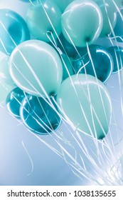 Blue air balloons background, big bunch of a helium balloons, happy birthday celebration, surprise for holiday, party decoration