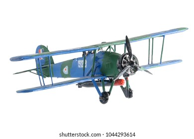 Blue airplane assembled painted by child isolated on the white background