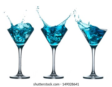 Blue alcohol cocktail set with splash isolated on white