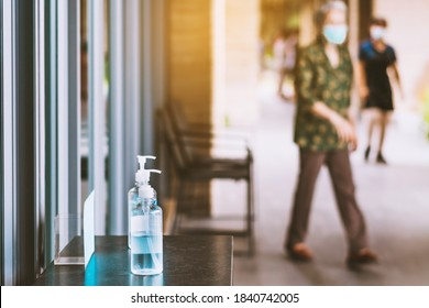 Blue alcohol gel bottle for hands cleaning to prevent the spreading of the Corona virus (Covid-19), Place the entrance service for customers  in the cafe. Healthcare concept. New normal lifestyle.