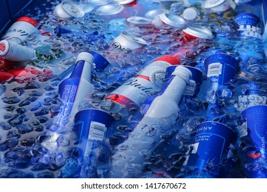 Blue aluminiumBud Lite beer cans inside the bucket with water and ice. Miami, Fl. may 23, 2019