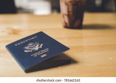 Blue American Passport on Table In Coffeshop