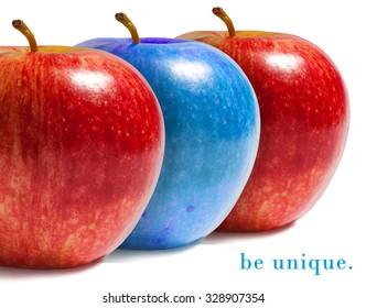 Blue apple between red ones.