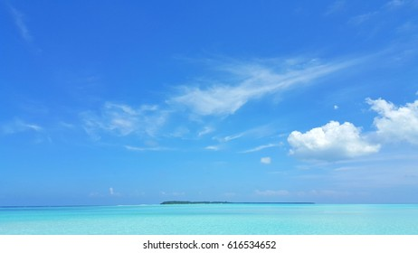 Blue aqua sea and sky clouds background in summer