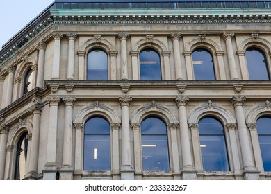 Blue arched windows on an old stone building in Saint John, Canada