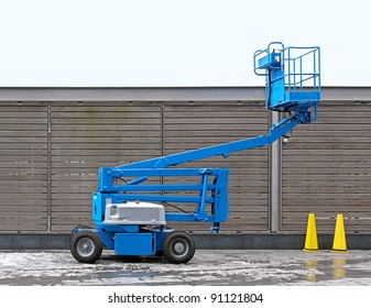 Blue articulated boom lift for construction work