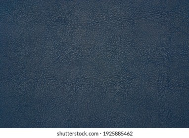 blue artificial leather with waves and folds on PVC base