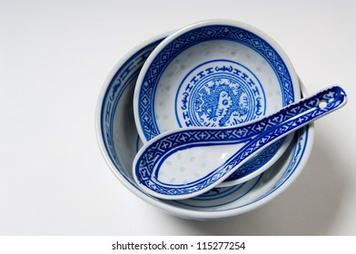 Blue asian soup bowls and spoon