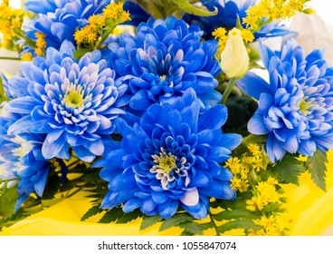 Blue aster flowers and other species in a floral bouquet