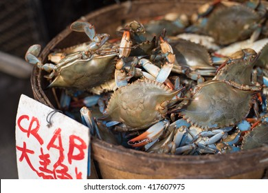 Blue atlantic crabs for sale at an outdoor market in Chinatown, New York City.