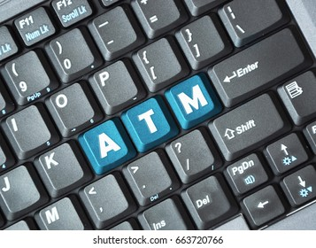 Blue atm key on keyboard