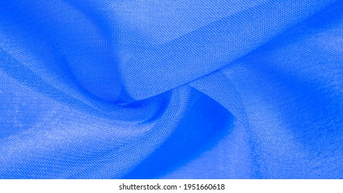 blue azure silk fabric. Very lightweight viscose fabric with a pleasant shine. Perfect for adding elegance to your online projects. texture background, pattern