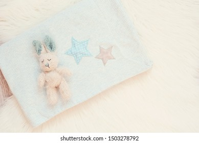 Blue Baby Blanket And Bunny Toy On A White Fur Carpet. Baby Mockup. Newborn Baby Concept. Baby Boy Shower Invitation
