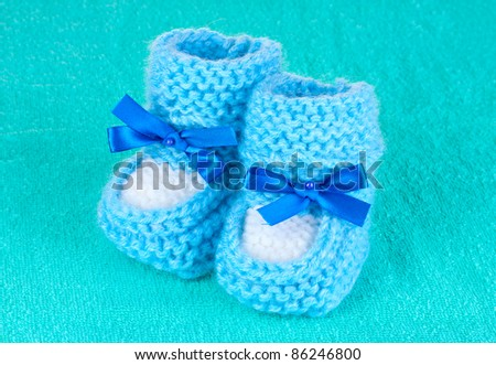 d3e904138f63 Blue Baby Booties On Blue Background Stock Photo (Edit Now) 86246800 ...
