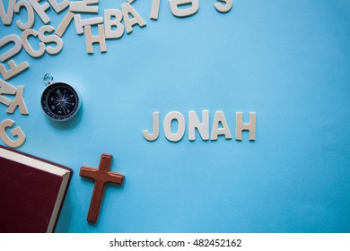 Blue background with the Bible book of Jonah