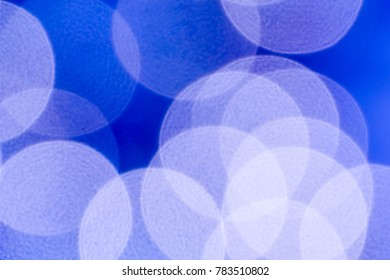 Blue background of big bokeh circles.