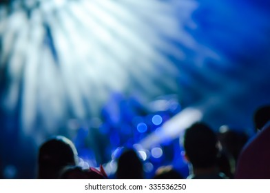 Blue background with bokeh effect.  Stage lights on a concert. Out of focus