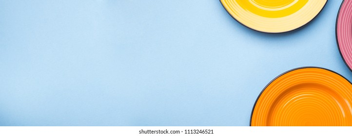 Blue background with colorful ceramic dishes. Long banner