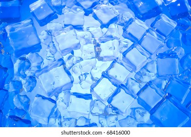 Blue background with cube ice. Fresh water