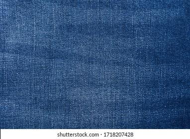 Blue background, denim jeans background.