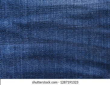 Blue background, denim jeans background. Jeans texture, denim fabric. Texture of denim or blue jeans background.