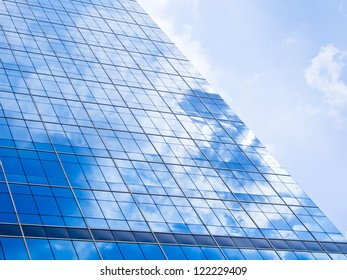blue background of glass high rise building skyscrapers in modern futuristic downtown at  Business concept of successful industrial architecture