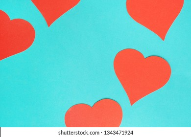 Blue background with red hearts. Gobo mask light effect in the shape of a heart. Valentine's day concept card.