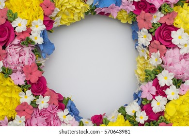 Blue background with red, pink, white, purple flowers in a circle. Postcard for the holiday (Mother's Day, Easter, birthday, congratulations, Valentine's Day). Place for writing (letters). mock up