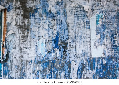 Blue background with ruined peeling papers - Abstract texture
