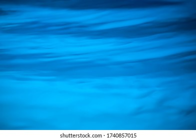 Blue background textures of a waterpool at night with a white light