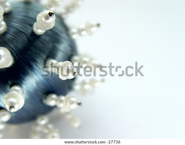 Blue ball taken closeup, Christmas tree ornament isolated on white background