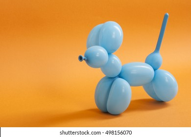 Blue balloon dog on orange