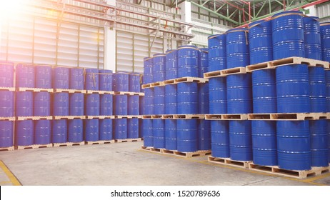 Blue barrel tank on the wood pallet in warehouse storage yard , Industrial and Warehouse business concept