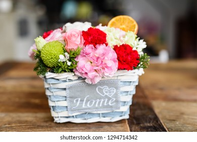 Blue basket with arranged flowers