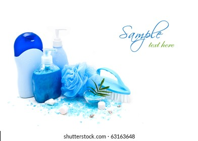 Blue bath accessories with seashells isolated on white