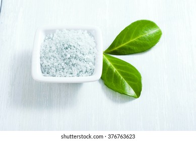 blue bath salt on old white wood table